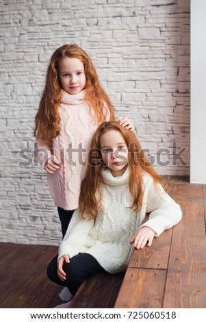 Redheaded twins kiss