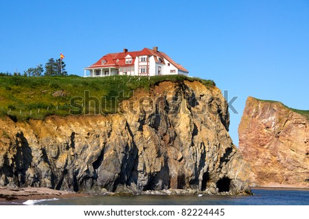 The Red House on top of the cliff on the edge of the water.Percé (City) Quebec, Canada