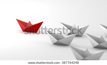 The red paper boat paves the way for white boats. Metaphor of followers and leader. Close-up view. - stock photo