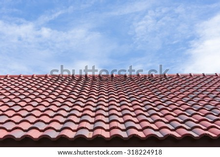 the red roof tile with the blue sky