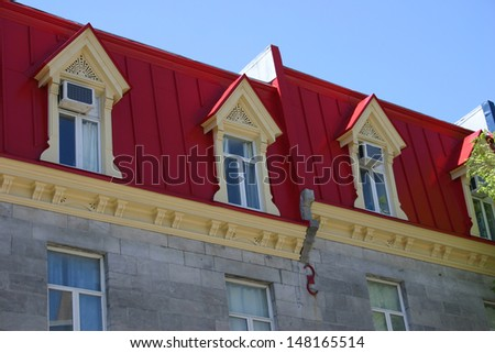 The red rooftops of a row of townhouses in Montreal, Quebec - stock photo