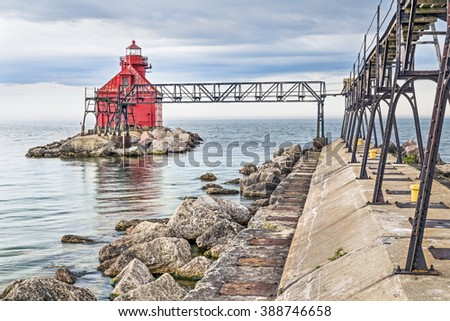 The red Sturgeon Bay Ship Canal North Pierhead Lighthouse stands on the Lake Michigan coast of Door County, Wisconsin. - stock photo