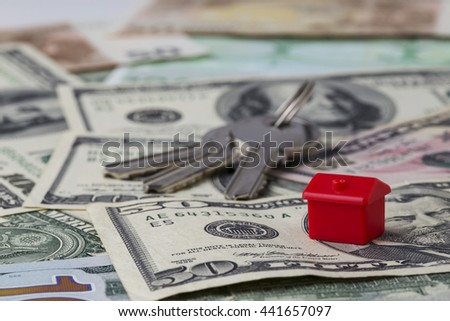 the red toy house on a money background