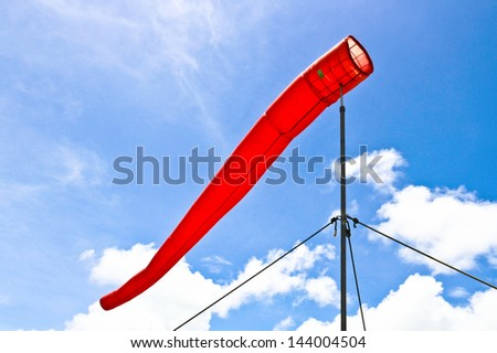 The red wind indication and blue sky