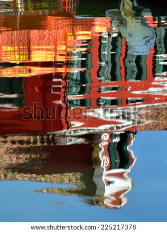 The reflection of a colorful houses in water canal, Burano island, Venice,  landmark of Veneto region, Italy