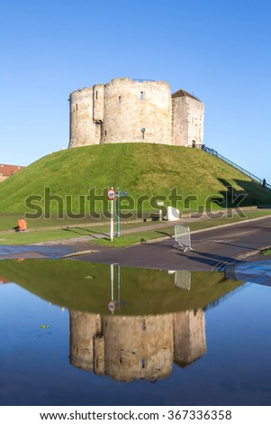 The reflection of Clifford's Tower, York, UK, after heavy rain made the River Ouse flood. - stock photo
