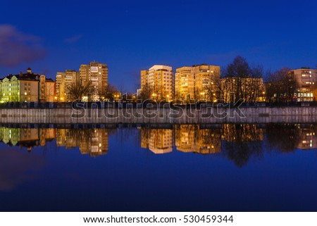 The reflection of the Fishing Village in a river in evening, Kaliningrad, Russia