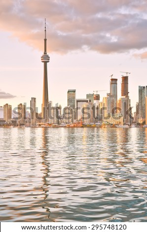 The reflection of Toronto skyline at dusk in Ontario, Canada. - stock photo