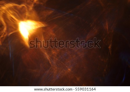 The refraction effect of light in the dark glow of the flames fire color fractal creative background Wallpaper