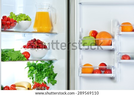 the refrigerator with healthy food fruits and vegetables - stock photo