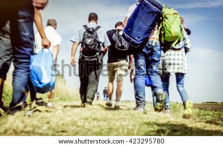 The refugees migrate to Europe. blurred, bokeh background, defocused - stock photo