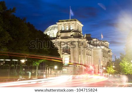 The Reichstag Parliament building Glass Dome night car light streaks Berlin Germany Tiergarten Animal Garden Europe - stock photo