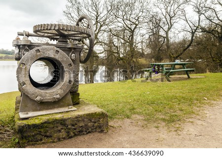 The remains of  original cast iron box valve on display  at Knypersley Reservoir. Stoke On Trent, Staffordshire, England.