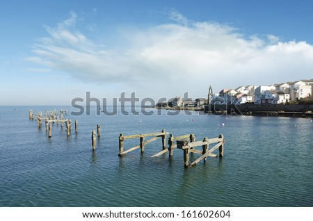 The remains of the old pier at Swanage on the Jurassic Coast in Dorset - stock photo