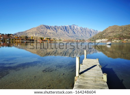 The Remarkable and jetty at Lake Wakatipu, Queenstown, New Zealand. - stock photo