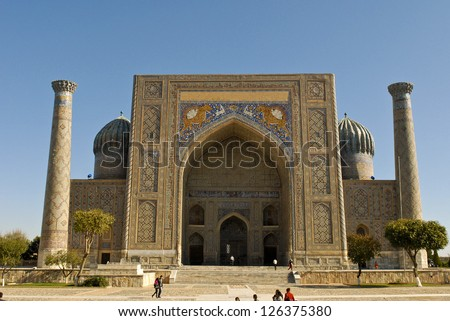 The remarkable facade of the Shir Dor Madrassa at the Registan in Samarkand, Uzbekistan - stock photo