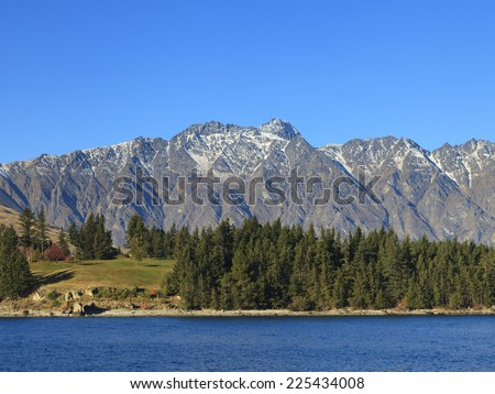 The Remarkables mountain and Lake Wakatipu in Queenstown, Otago region, South Island, New Zealand. - stock photo