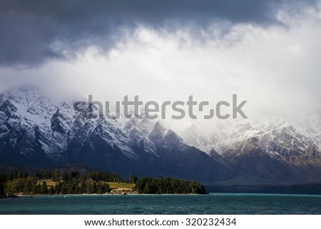 The Remarkables mountain range with lake Wakatipu in the foreground, South Island, Central Otago, New Zealand - stock photo