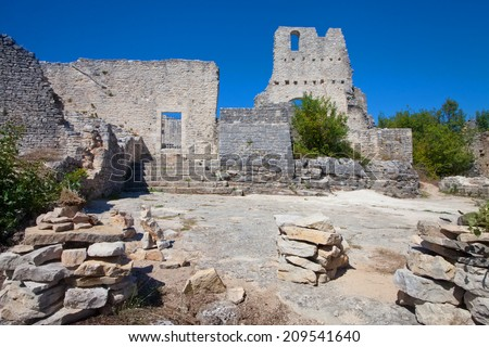 The remnants of the destroyed medieval castle in abandoned city of Dvigrad, Croatia (abandoned and destroyed in ab. XIII-XV century) - stock photo