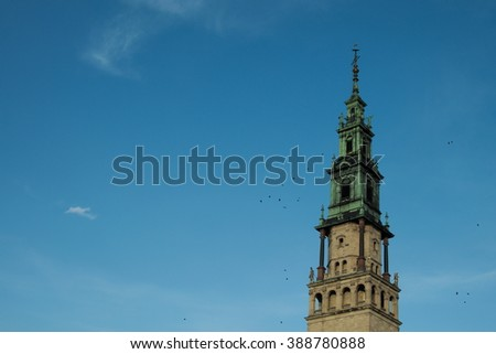 the renovated tower of the Jasna Gora monastery glitters in pale winter sunlight - stock photo