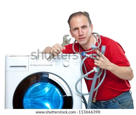 The repairman near the washing machine - stock photo