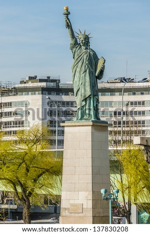 The replica of the Statue of Liberty (1889) on the Ile aux Cygnes (Isle of the Swans) in Paris, France - stock photo