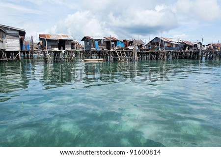 The Residence houses of the Sea Bajau community  in Omada Island,Sabah,Malaysia - stock photo