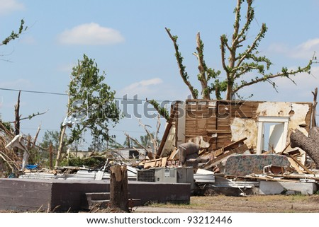 The resiilience of nature is on display as trees sprout leaves on badly damaged limbs in an attempt to recover from damage caused by the direct impact of an EF-5 tornado with winds over 200+ mph.