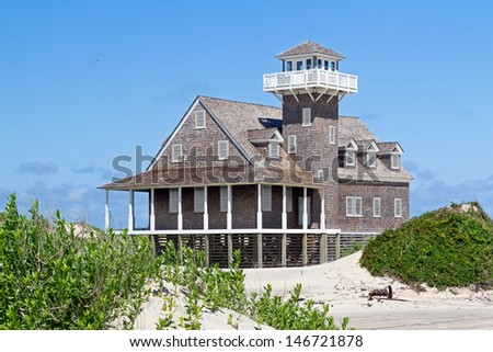 The restored Oregon Inlet Life Saving Station stands on the North Carolina Outer Banks coast at Pea Island National Wildlife Refuge (Bodie Island) in Cape Hatteras National Seashore. - stock photo