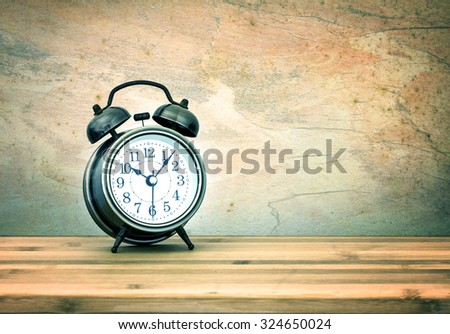 the retro and vintage style of Old fashioned the alarm clock - stock photo