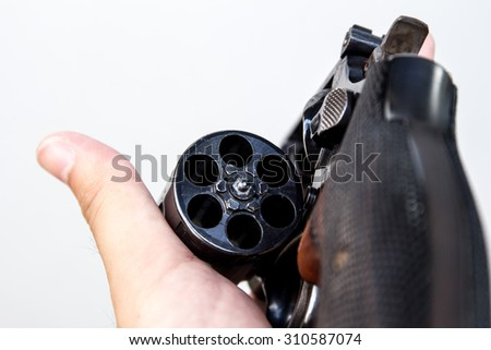 The revolver hand gun holding on hand in white background. - stock photo