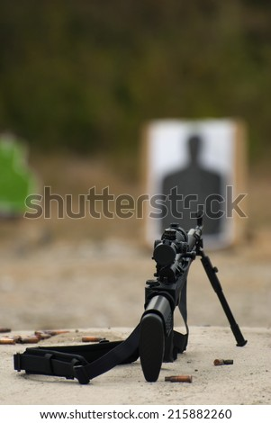 The rifle on the bipod aimed at target - stock photo
