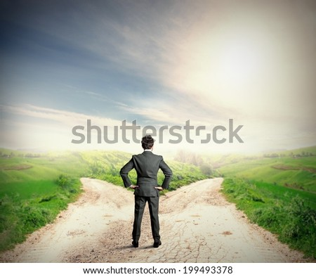 The right destination concept with businessman at crossroad - stock photo