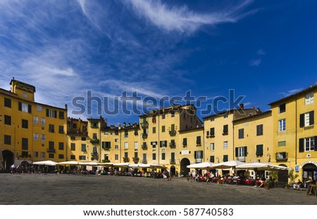 The ring of buildings around the square, follows the elliptical shape of the former second-century Roman amphitheater of Lucca_Lucca Tuscany Italy