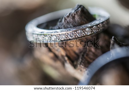 The ring of the bride being photographed outside. - stock photo