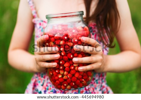 The Ripe strawberries in a glass container. - stock photo