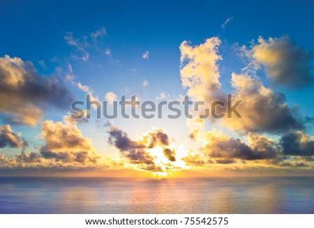 The rising sun over the sea