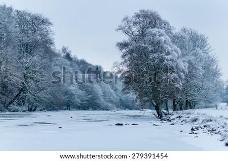 The river Dochart in Killin, Scotland frozen in mid winter. - stock photo