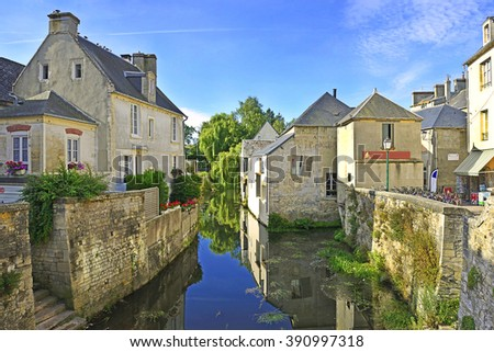 The river embankment of town Bayeux. Normandy, France - stock photo
