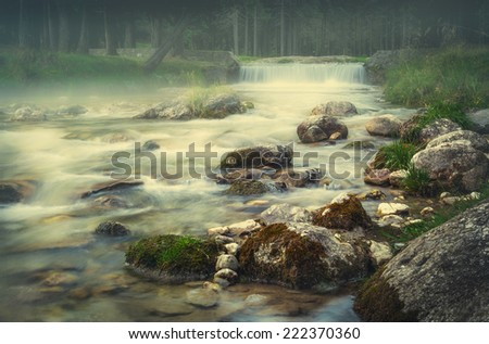 The river flows - stock photo