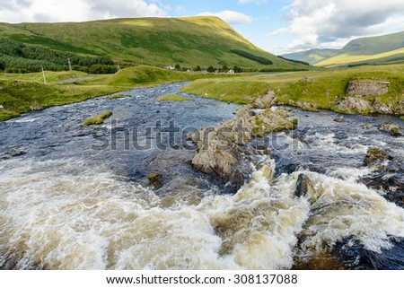 The river Lyon and village of Pubil in upper Glen Lyon in Perthshire, Scotland in summer.