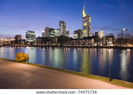 The river Main at Frankfurt, Germany, with the city skyline at dusk.