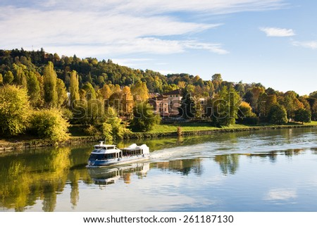 The river Po and surrounding park in autumn seen from the Umberto I bridge in Torino, Italy - stock photo