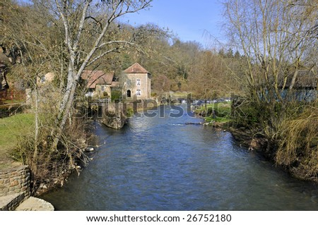 The river Sarthe at Saint-Ceneri-le-Gerei in France,department of the Orne