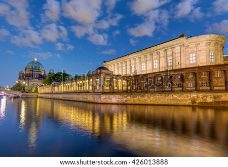 The river Spree, the cathedral and the Museum Island in Berlin at night - stock photo
