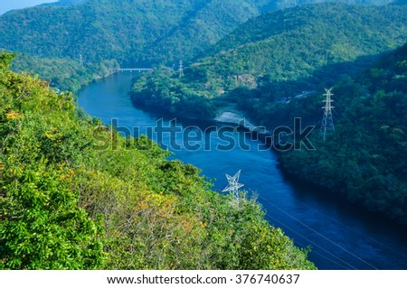 The river with forest and electricity post in Tak, Thailand / The river with forest and electricity post