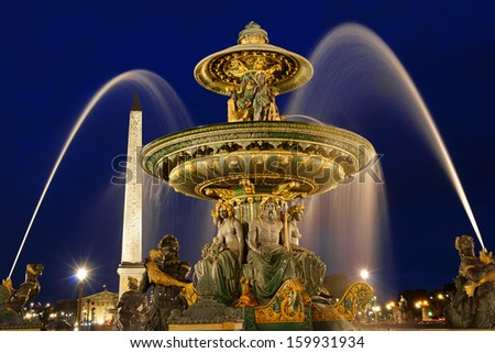 The rivers fountain (Fontaine des Fleuves) in Place de la Concorde by night in Paris, France. Selective focus.