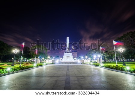 The Rizal Monument at night, at Rizal Park, in Ermita, Manila, The Philippines. - stock photo