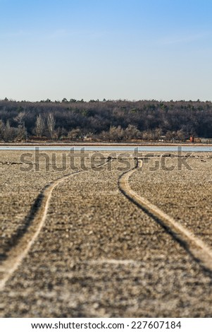 The road along the bottom of the dried lake - stock photo