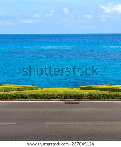 The road between sea view on blue sky - stock photo
